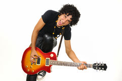 Teen playing guitar isolated. Portrait of trendy teen boy playing electric guitar with funny grin isolated Stock Photo