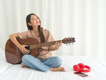 Free Teen Playing Guitar Relax In Bedroom, Enjoy Leisure Weekend At Home Royalty Free Stock Photo - 186726895