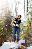 Teen playing saxophone in the snow Stock Photos