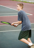 Teen Playing Tennis - Approach. Teenage boy playing tennis, approaching the net Royalty Free Stock Photos