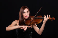 Teen playing violin Royalty Free Stock Image