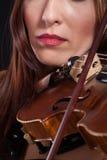 Teen playing violin Royalty Free Stock Photos
