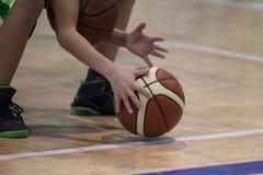 Teen plays basketball. Basketball player royalty free stock photos