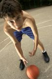 Teen plays in basketball on the street royalty free stock photo