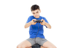 Teen plays on the joysticks lying on the floor Royalty Free Stock Image