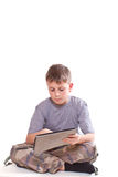 Teen plays on the tablet computer Stock Photos