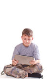 Teen plays on the tablet computer Stock Photo