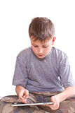 Teen plays on the tablet computer Royalty Free Stock Images