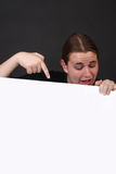 Teen pointing at blank sign Stock Photo