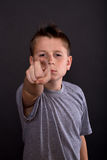 Teen points the finger Stock Photo