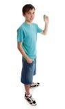 teen pojkeholdingpengar Fotografering för Bildbyråer