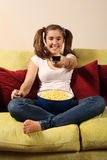 Teen with popcorn Royalty Free Stock Photos