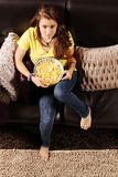 Teen with popcorn container Royalty Free Stock Images