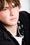 Teen portrait. Teen male portrait against wall close up stock images
