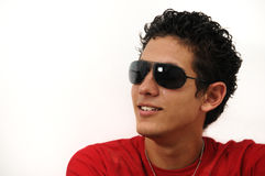 Teen portrait. Portrait of young man wearing sunglasses with attitude Royalty Free Stock Image