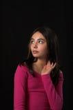 Teen posing over black backdrop Stock Photos