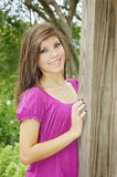 Teen posing in a park. Young beautiful girl outdoor portrait close up Royalty Free Stock Image
