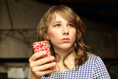 Teen posing with a smartphone Royalty Free Stock Photos