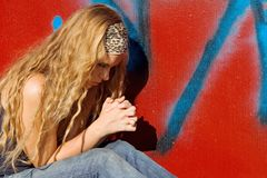 Teen praying. Teen, youth teenager praying hands clasped in prayer Stock Photography