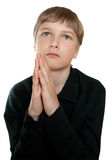 Teen prays to God. Stock Photography