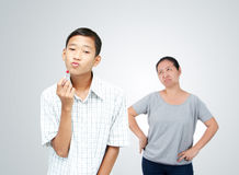 Teen problem poncept. Asian teen boy and mother is acting for the Gender Identity in boys,teen and family problem concept Stock Images