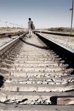 Teen  problems. Teen boy with problem walking on railroad Stock Image