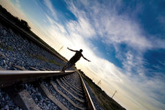 Teen  problems. Teen boy with problem walking on railroad Stock Photo