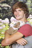 Teen Proud of His New Pup Stock Image