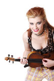 Teen punk girl playing fiddle. Teen rebel punk girl playing fiddle by her hands over white Stock Image
