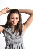 Teen putting up her hair Stock Photography