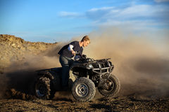Teen on quad four wheeler Royalty Free Stock Photos