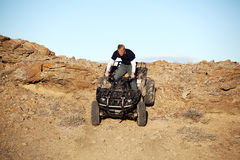 Teen on quad - four wheeler in hills Stock Image