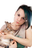 Teen and rabbit Stock Images