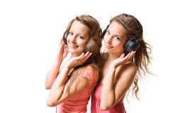 Teen radio. Teen radio, two gorgeous cute brunette teen girls having fun with headphones and music Stock Photos