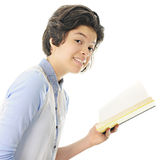 Teen Reader. An attractive teen girl smiling at the viewer with the opened book she's been reading still in her hand.  On a white background Stock Image