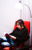 Teen reading Royalty Free Stock Image