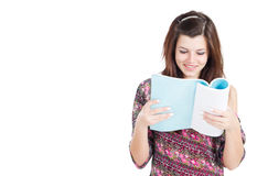 Teen reading book Stock Images