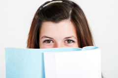 Teen reading book Stock Photos