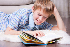 Teen reading a book. Royalty Free Stock Photo