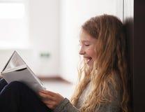 Teen reading book Stock Photos