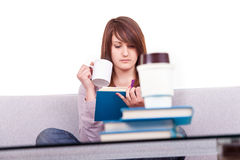 Teen reading a book  home Royalty Free Stock Photos