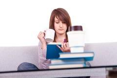 Teen reading a book  home Royalty Free Stock Photos