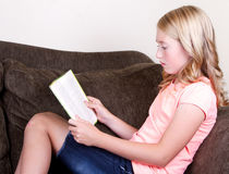 Teen reading a book Stock Images