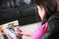 Teen reading magazine Stock Photo