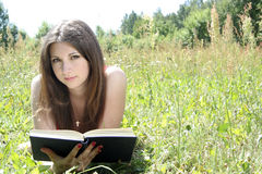 Teen reading in meadow Royalty Free Stock Images