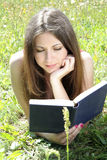 Teen reading in meadow Royalty Free Stock Photo