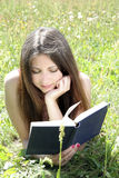 Teen reading in meadow Royalty Free Stock Photography