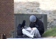 Teen reading outdoor. Teenager reading outdoor Stock Images
