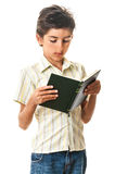 Teen reading paper book Royalty Free Stock Images