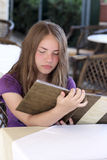 Teen reads menu Stock Photography
